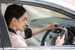 Beautiful young asian woman using map in mobile in a car Royalty Free Stock Image