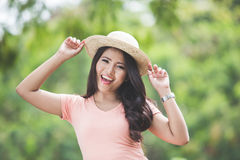 Beautiful young asian woman wearing round hat on a park Stock Photo