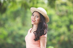 Beautiful young asian woman wearing round hat on a park Stock Image