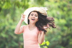 Beautiful young asian woman wearing round hat on a park Royalty Free Stock Image