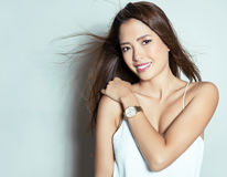 Beautiful young asian woman with wearing wrist watch Royalty Free Stock Photos