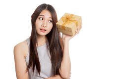Beautiful young Asian woman wonder what in golden gift box. Isolated on white background royalty free stock image