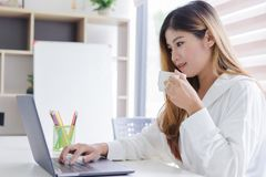 Beautiful young asian woman working with laptop royalty free stock photos