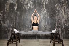 Beautiful young asian Woman Working Out, doing Pilates Exercise in Sportswear. Splits with Yoga Asana, Stretching royalty free stock photos