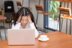 Beautiful young asian woman working and thinking with problem to stress and unhappy. Stock Images
