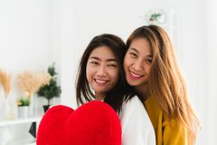 Beautiful young asian women LGBT lesbian happy couple sitting on bed hugging and smiling together in bedroom at home. Royalty Free Stock Photo