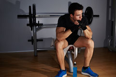 Beautiful young athlete resting after benching Stock Photos