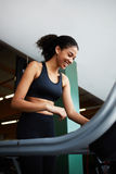 Beautiful young athlete warming up on the treadmill Royalty Free Stock Photos