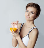 Beautiful young athletic girl energetic happy drinking orange juice, healthy lifestyle Royalty Free Stock Photos