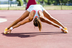 Beautiful young athletic woman stretching in summer Stock Image