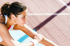 Beautiful young athletic woman stretching in summer Royalty Free Stock Photography