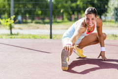 Beautiful young athletic woman stretching in summer Stock Images