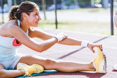 Beautiful young athletic woman stretching in summer Royalty Free Stock Image
