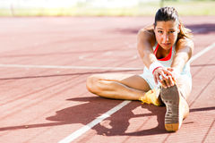 Beautiful young athletic woman stretching in summer Stock Photos