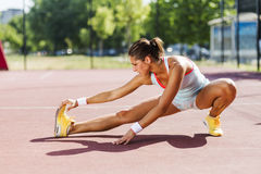Beautiful young athletic woman stretching in summer Stock Photography