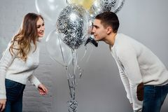 Beautiful young attractive couple celebrating a birthday or a Valentine`s day holiday. royalty free stock images