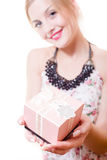 Beautiful young attractive woman blue eyes blond girl holding pink box gift in hands & looking at camera portrait on on white Royalty Free Stock Images