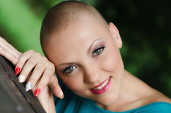 Beautiful young bald woman - cancer survivor Stock Images