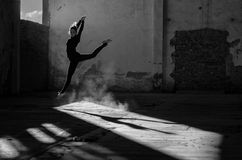 Beautiful young ballerina dancing in abandoned building Stock Photos