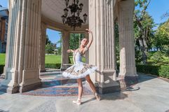 Beautiful young ballerina dancing, standing in Royalty Free Stock Photo