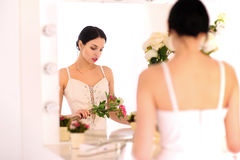 Beautiful young ballerina standing against mirror Stock Image