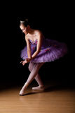 Beautiful young ballet dancer wearing lilac tutu royalty free stock image