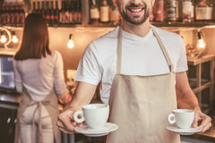 Beautiful young baristas Royalty Free Stock Images