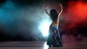 Beautiful young belly dancer in blue exotic stock footage