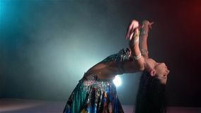 Beautiful young belly dancer starts dancing, slow stock video