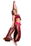 Beautiful young belly dancer with a veil Stock Image