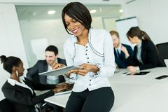 Beautiful, young, black, african businesswoman using a tablet at Stock Photography