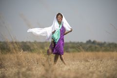 African lady walking in field stock photography