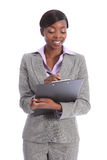 Beautiful young black business woman writing Royalty Free Stock Photo