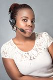 Beautiful young black call center agent talking Stock Photo