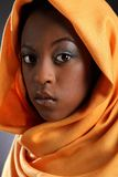 Beautiful young black girl wearing headress Stock Images