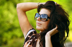 Beautiful young black hair woman in sunglasses Royalty Free Stock Photography
