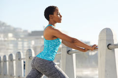 Beautiful young black sports woman leaning on railing outdoors Royalty Free Stock Images