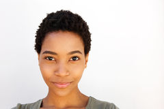 Beautiful young black woman against white background. Close up portrait of beautiful young black woman against white background Royalty Free Stock Photography