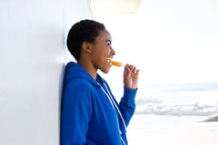 Beautiful young black woman eating ice cream outside Royalty Free Stock Photography