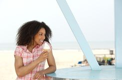 Beautiful young black woman enjoying ice cream Royalty Free Stock Images