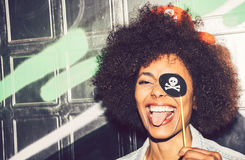 Beautiful young black woman having fun with a fake party pirate Stock Image