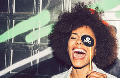 Beautiful young black woman having fun with a fake party pirate stock photos