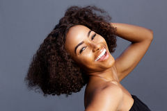 Beautiful young black woman laughing with hand in hair Royalty Free Stock Images