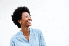 Beautiful young black woman looking away and smiling Stock Photo