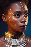 Beautiful black girl with crystal crown. Beautiful young black woman with perfect skin and pink tone make up. Model with colourful crystal crown on head. Beauty Stock Photography