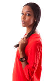 Beautiful young black woman in red dress Stock Photo