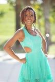Beautiful young black woman smiling Stock Photos