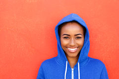 Beautiful young black woman smiling against red background Stock Image