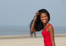 Beautiful young black woman smiling at the beach Royalty Free Stock Photo