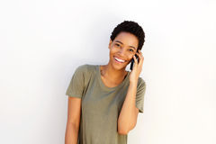 Beautiful young black woman smiling with cellphone Royalty Free Stock Images